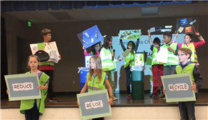students put on skit teaching about composting and recycling