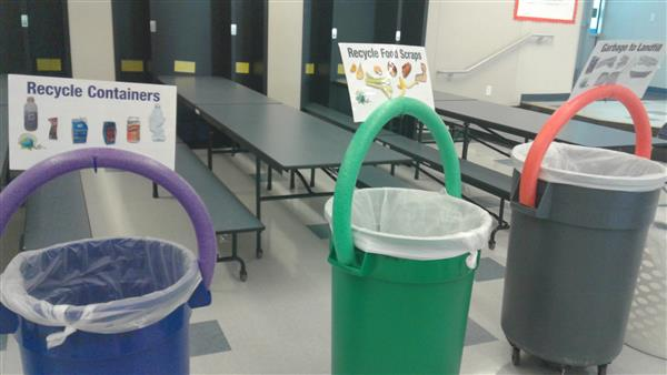 students use special bins to sort compost and recycling from regular trash in effort to reduce waste