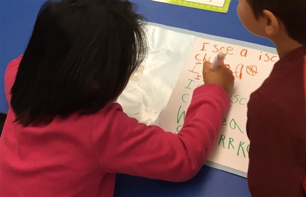 kindergartener works on transportation words