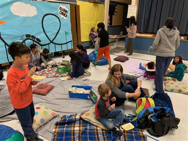 students and families enjoy amusement park reading night