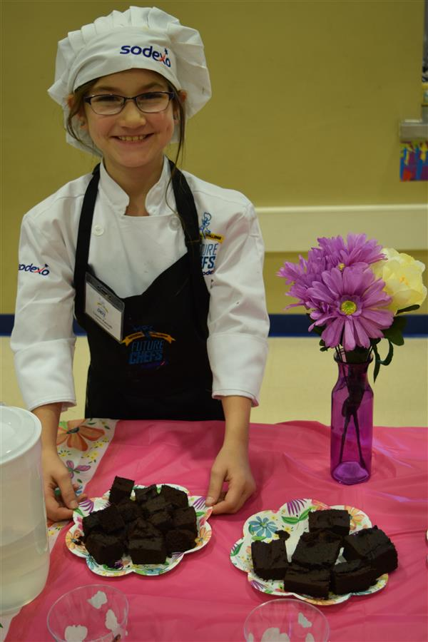 Student chef presents her winning dish
