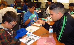 Northrop Grumman engineer works with Columbia Middle students on hands-on project