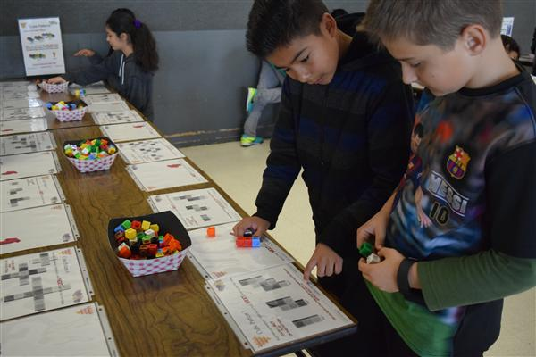 Students work on math challenges during schoolwide math festival
