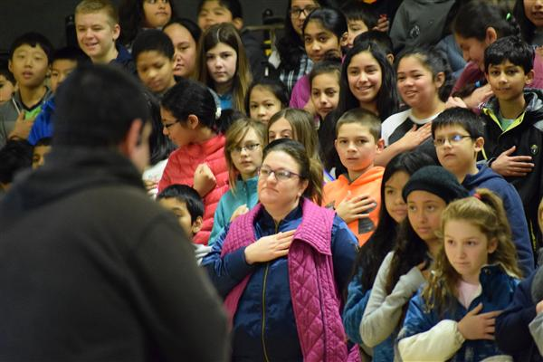 Students and staff take the anti-bullying pledge led by assault victim Bryan Stow