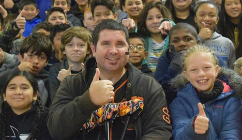 Students surround Bryan Stow in support of his anti-bullying campaign