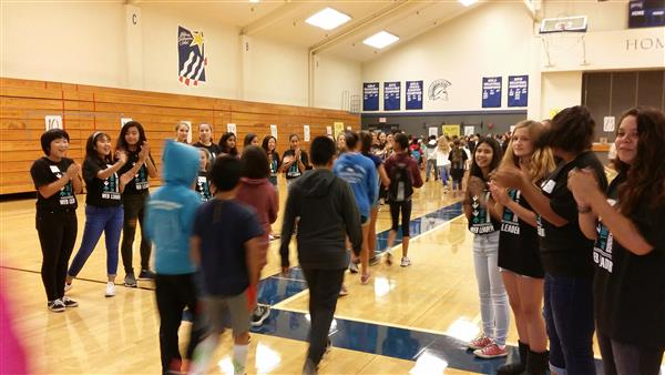 sixth graders cheered as they enter gym for first time at orientation
