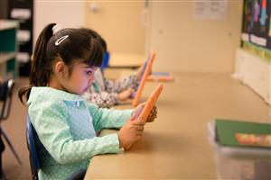 Preschool students explore technology on iPads