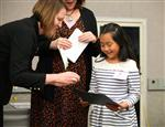 Melany receives her Every Student Succeeding certificate