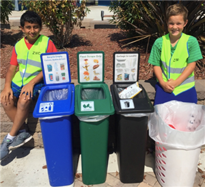 student ambassadors teach each other how to compost and recycle