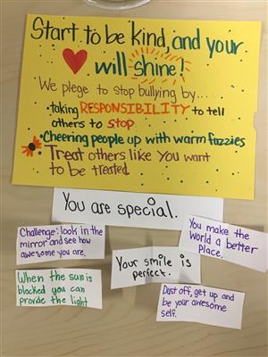 students pledge to stop bullying and to treat others well